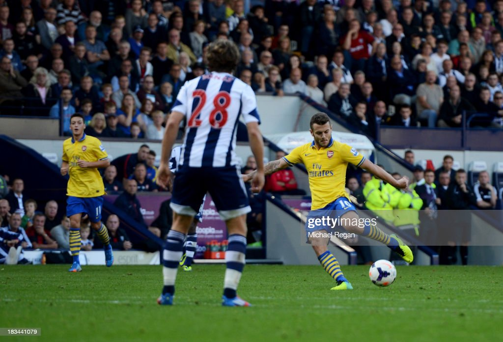 <a gi-track='captionPersonalityLinkClicked' href=/galleries/search?phrase=Jack+Wilshere&family=editorial&specificpeople=5446655 ng-click='$event.stopPropagation()'>Jack Wilshere</a> of Arsenal scores their first goal during the Barclays Premier League match between West Bromwich Albion and Arsenal at The Hawthorns on October 6, 2013 in West Bromwich, England.