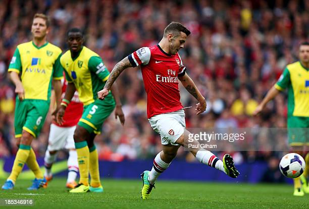 Jack Wilshere of Arsenal scores their first goal during the Barclays Premier League match between Arsenal and Norwich City at Emirates Stadium on...