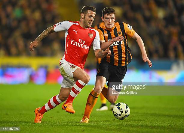 Jack Wilshere of Arsenal takes on Andrew Robertson of Hull City during the Barclays Premier League match between Hull City and Arsenal at KC Stadium...