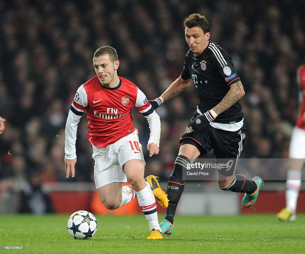 <a gi-track='captionPersonalityLinkClicked' href=/galleries/search?phrase=Jack+Wilshere&family=editorial&specificpeople=5446655 ng-click='$event.stopPropagation()'>Jack Wilshere</a> of Arsenal takes on <a gi-track='captionPersonalityLinkClicked' href=/galleries/search?phrase=Mario+Mandzukic&family=editorial&specificpeople=4476149 ng-click='$event.stopPropagation()'>Mario Mandzukic</a> of Bayern during the UEFA Champions League Round of 16 first leg match between Arsenal FC and Bayern Muenchen at Emirates Stadium on February 19, 2013 in London, England.