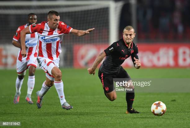Jack Wilshere of Arsenal takes on Nenad Krsticic of Red Star during the UEFA Europa League group H match between Crvena Zvezda and Arsenal FC at...