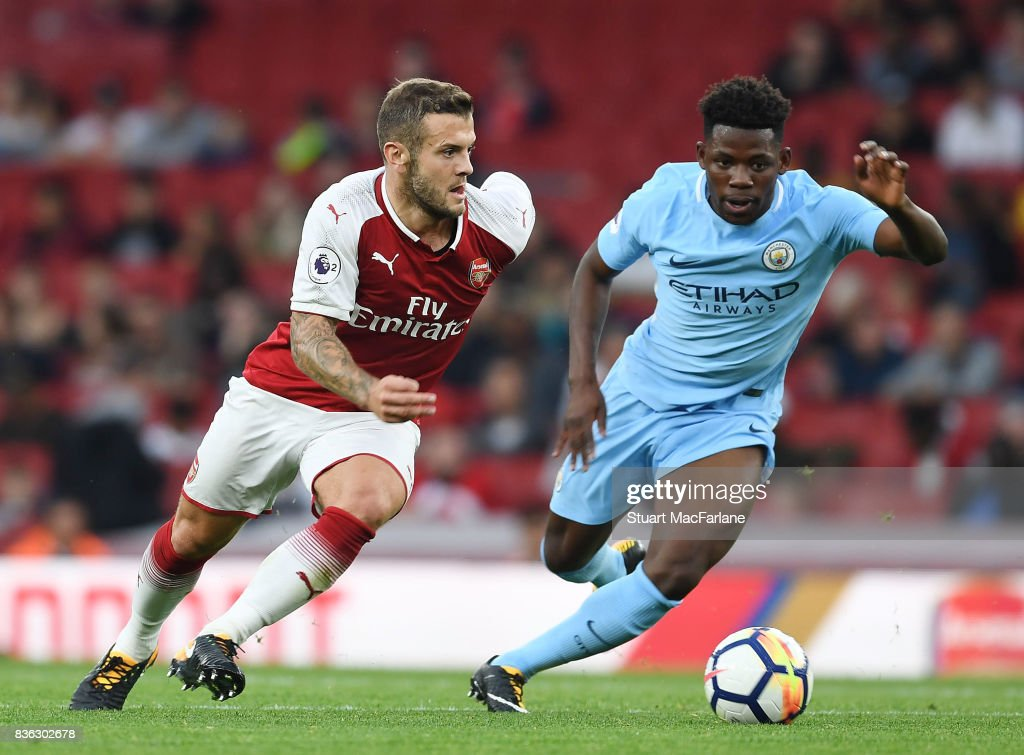 Jack Wilshere of Arsenal takes on Tomiwa Dele-Bashiru of Man City during the Premier League 2 match between Arsenal and Manchester City at Emirates Stadium on August 21, 2017 in London, England.