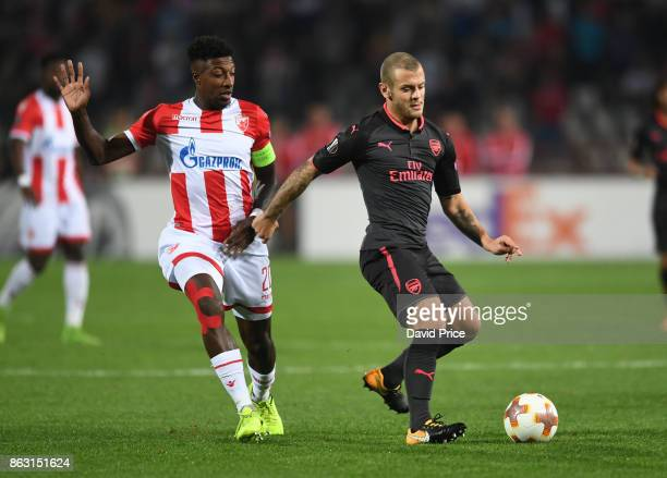 Jack Wilshere of Arsenal tpasses under pressure from Mitchell Donald of Red Star during the UEFA Europa League group H match between Crvena Zvezda...