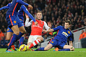 Jack Wilshere of Arsenal twists his ankle under a challenge from Paddy McNair of Manchester United during the match Arsenal v Manchester United in...