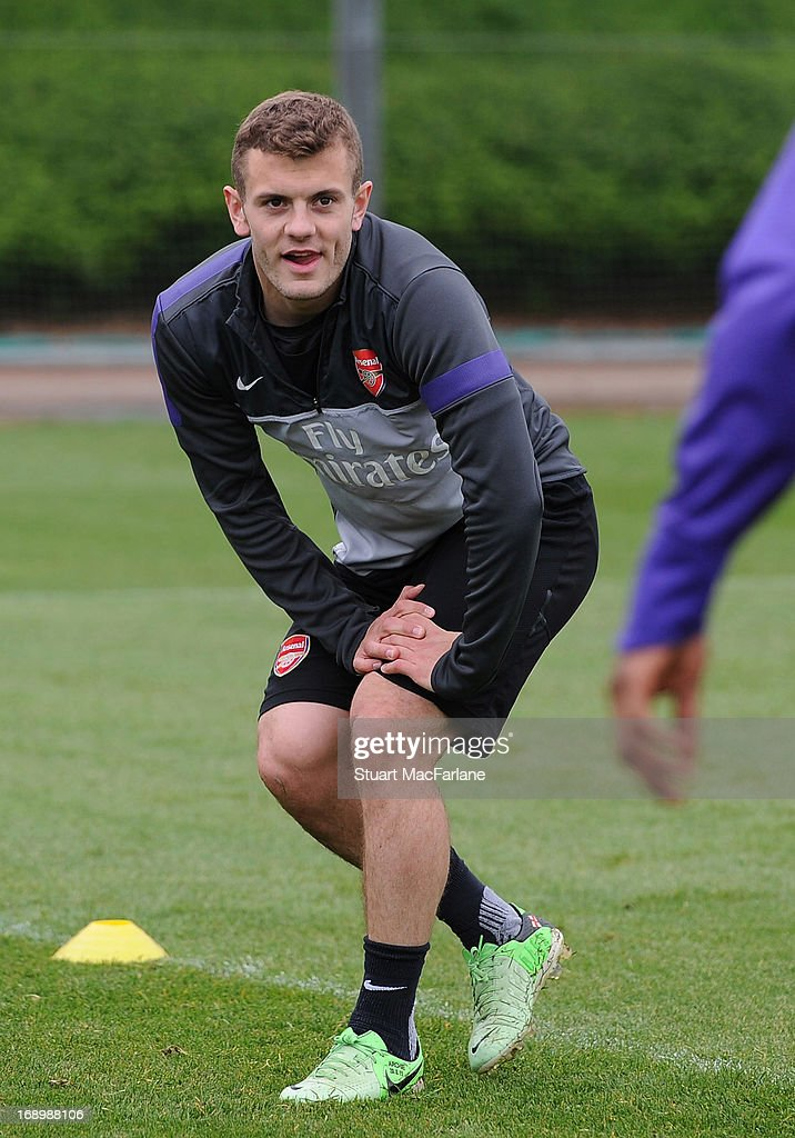 <a gi-track='captionPersonalityLinkClicked' href=/galleries/search?phrase=Jack+Wilshere&family=editorial&specificpeople=5446655 ng-click='$event.stopPropagation()'>Jack Wilshere</a> of Arsenal warms up during a training session at London Colney on May 18, 2013 in St Albans, England.