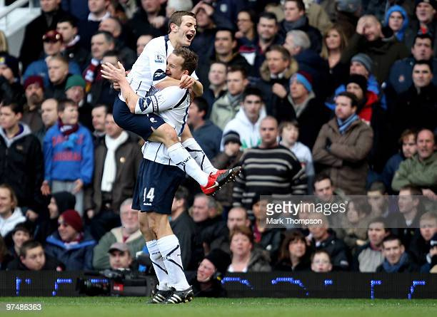 Jack Wilshere of Bolton Wanderers celebrates his goal with team mate Kevin Davies during the Barclays Premier League match between West Ham United...