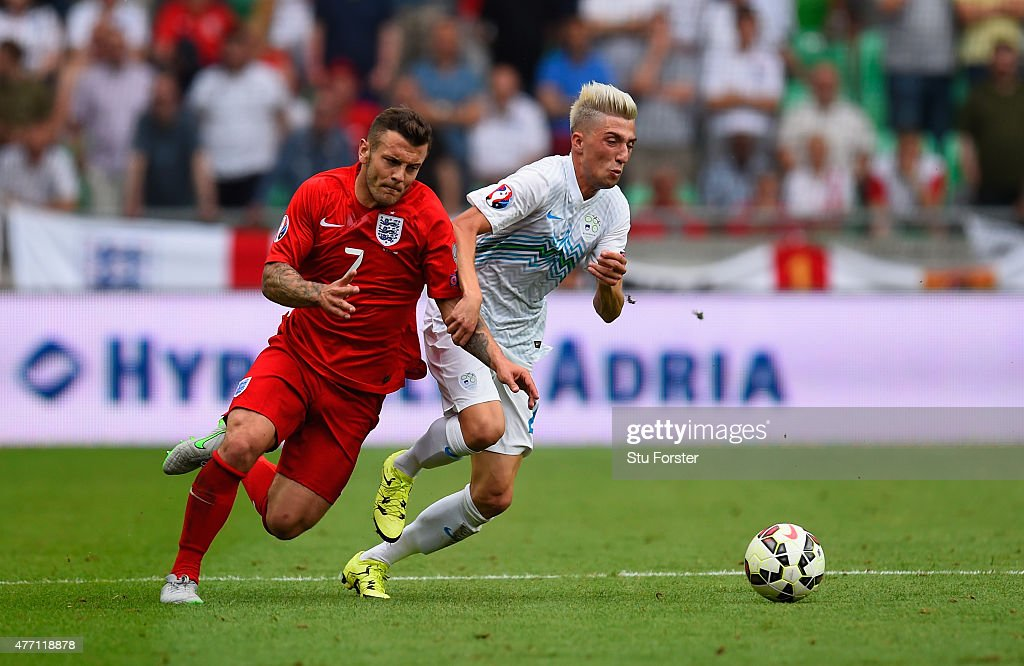 Jack Wilshere of England and Kevin Kampl of Slovenia fight for the ball during the UEFA EURO 2016 Qualifier between Slovenia and England on at the...