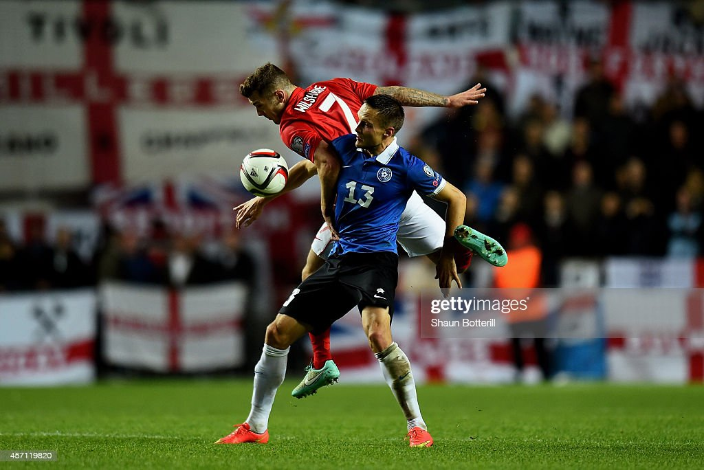 Jack Wilshere of England and Martin Vunk of Estonia compete for the ball during the EURO 2016 Qualifier match between Estonia and England at A. Le Coq Arena on October 12, 2014 in Tallinn, Estonia.