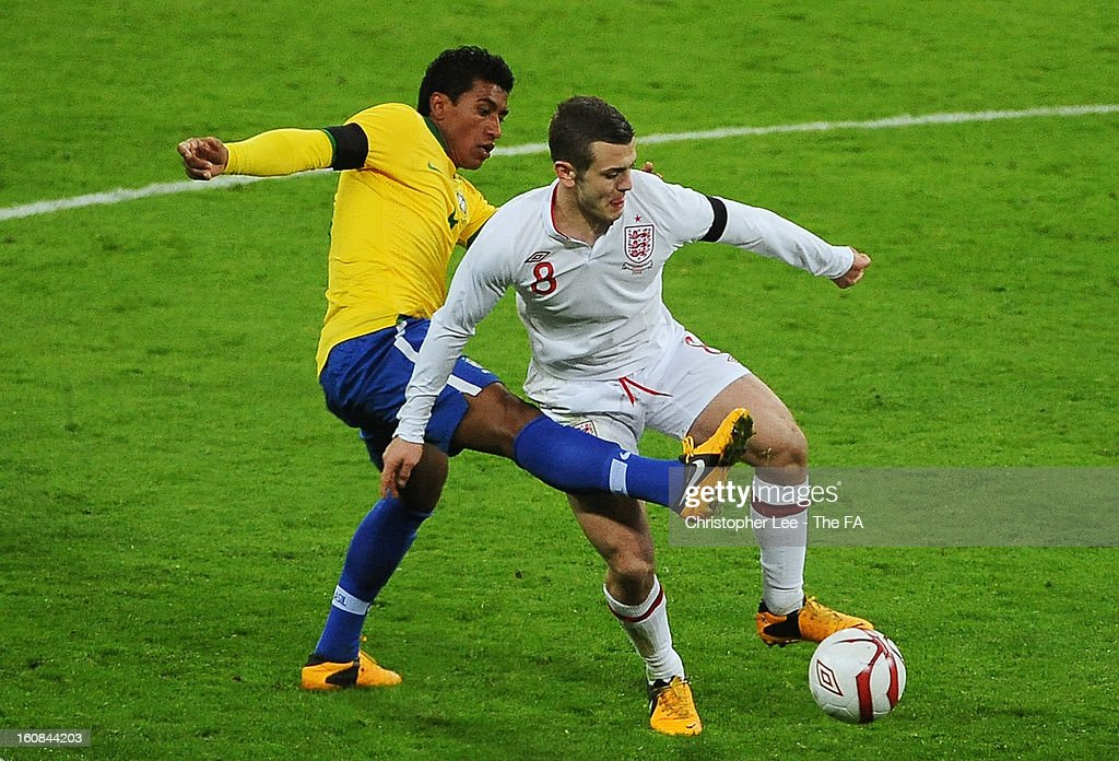 Jack Wilshere of England battles with Paulinho of Brazil during the International Friendly match between England and Brazil at Wembley Stadium on February 6, 2013 in London, England.