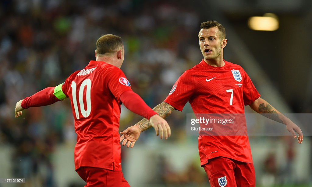 <a gi-track='captionPersonalityLinkClicked' href=/galleries/search?phrase=Jack+Wilshere&family=editorial&specificpeople=5446655 ng-click='$event.stopPropagation()'>Jack Wilshere</a> of England (R) celebrates scoring their first goal with <a gi-track='captionPersonalityLinkClicked' href=/galleries/search?phrase=Wayne+Rooney&family=editorial&specificpeople=157598 ng-click='$event.stopPropagation()'>Wayne Rooney</a> of England during the UEFA EURO 2016 Qualifier between Slovenia and England on at the Stozice Arena on June 14, 2015 in Ljubljana, Slovenia.