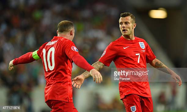 Jack Wilshere of England celebrates scoring their first goal with Wayne Rooney of England during the UEFA EURO 2016 Qualifier between Slovenia and...