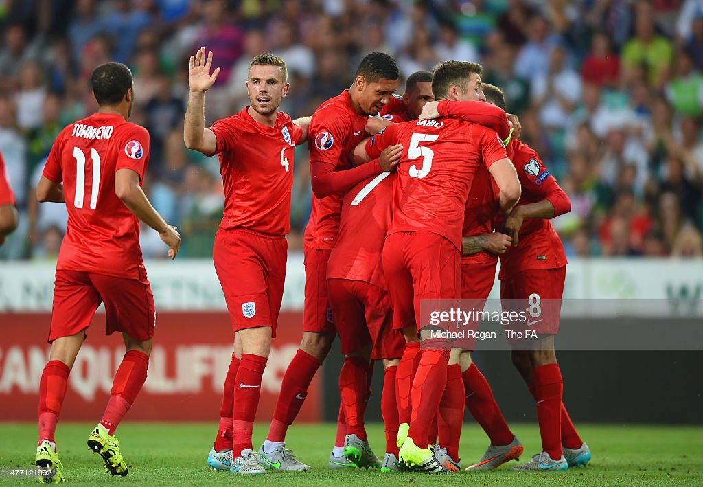 Jack Wilshere of England is mobbed by team mates after scoring the opening goal during the UEFA EURO 2016 Qualifier between Slovenia and England on...