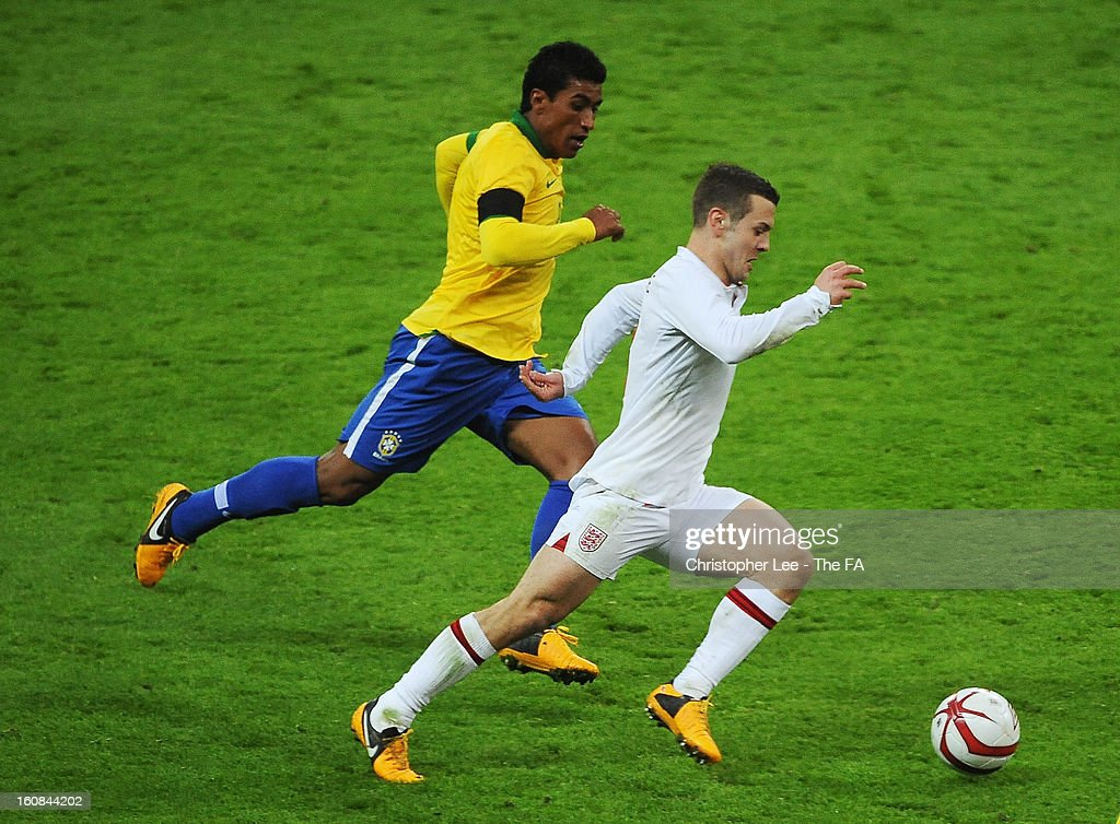 Jack Wilshere of England races away from Paulinho of Brazil during the International Friendly match between England and Brazil at Wembley Stadium on February 6, 2013 in London, England.