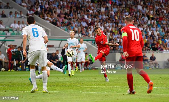 Jack Wilshere of England scores their second goal during the UEFA EURO 2016 Qualifier between Slovenia and England on at the Stozice Arena on June 14...