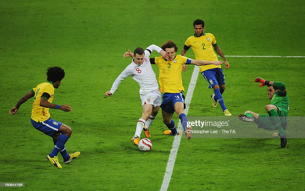 Jack Wilshere of England shoots as David Luiz of Brazil dives in during the International Friendly match between England and Brazil at Wembley Stadium on February 6, 2013 in London, England.