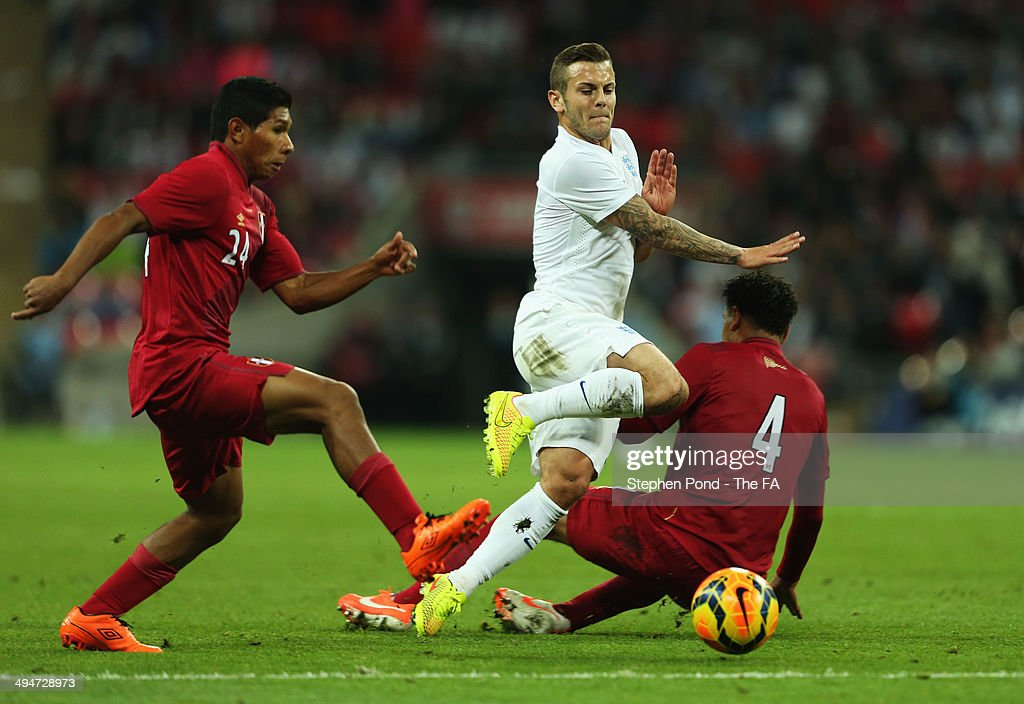 <a gi-track='captionPersonalityLinkClicked' href=/galleries/search?phrase=Jack+Wilshere&family=editorial&specificpeople=5446655 ng-click='$event.stopPropagation()'>Jack Wilshere</a> of England takes on <a gi-track='captionPersonalityLinkClicked' href=/galleries/search?phrase=Edison+Flores&family=editorial&specificpeople=8597891 ng-click='$event.stopPropagation()'>Edison Flores</a> (24) and Alexander Callens of Peru (4) during the International Friendly match between England and Peru at Wembley Stadium on May 30, 2014 in London, England.