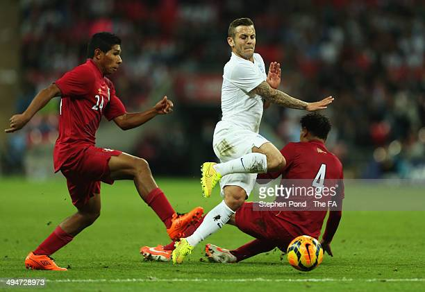 Jack Wilshere of England takes on Edison Flores and Alexander Callens of Peru during the International Friendly match between England and Peru at...