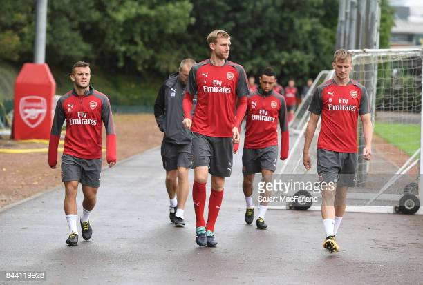 Jack Wilshere Per Mertesacker and Rob Holding of Arsenal before a training session at London Colney on September 8 2017 in St Albans England