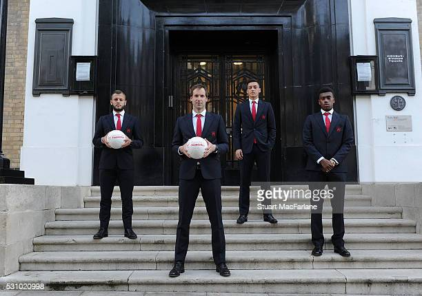 Jack Wilshere Petr Cech Mesut Ozil and Alex Iwobi of Arsenal at the old Arsenal Stadium before attending the Arsenal Foundation Ball at Emirates...