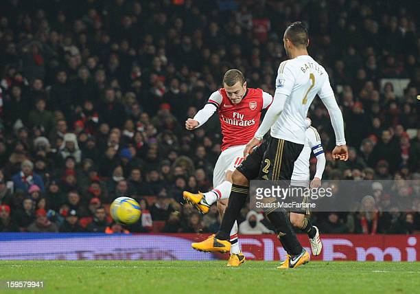 Jack Wilshere shoots past Swansea City goalkeeper Michel Vorm to score the Arsenal goal during the FA Cup Third Round Replay match between Arsenal...