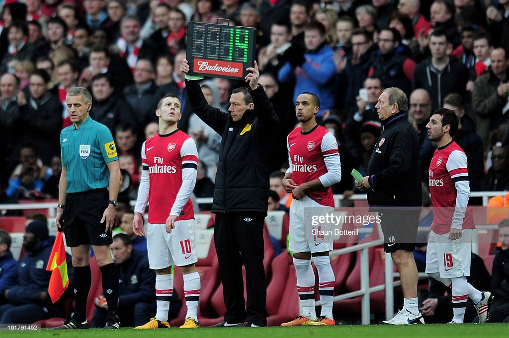 Jack Wilshere, Theo Walcott and Santi Cazorla of Arsenal prepare to come on as second half substitutes during the FA Cup with Budweiser fifth round match between Arsenal and Blackburn Rovers at Emirates Stadium on February 16, 2013 in London, England.