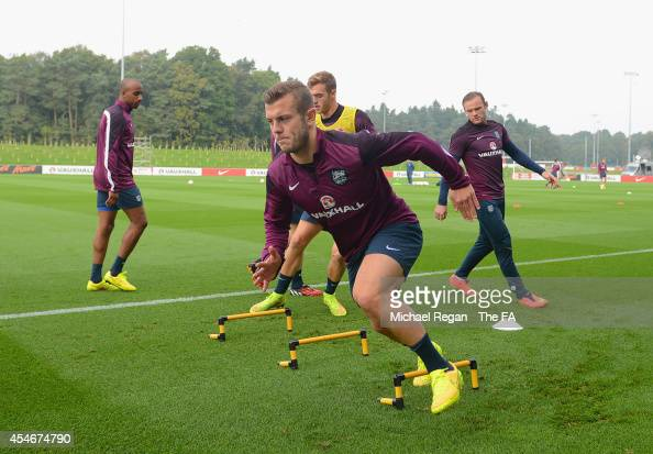 Jack Wilshere warms up during the England training session at St Georges Park on September 5 2014 in BurtonuponTrent England