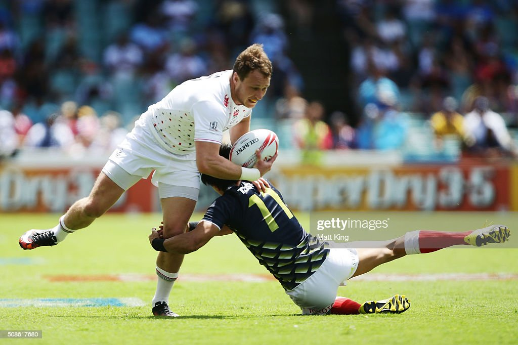 Jack Wilson of England is tackled by <a gi-track='captionPersonalityLinkClicked' href=/galleries/search?phrase=Chihito+Matsui&family=editorial&specificpeople=12753309 ng-click='$event.stopPropagation()'>Chihito Matsui</a> of Japan during the 20146 Sydney Sevens match between England and Japan at Allianz Stadium on February 6, 2016 in Sydney, Australia.
