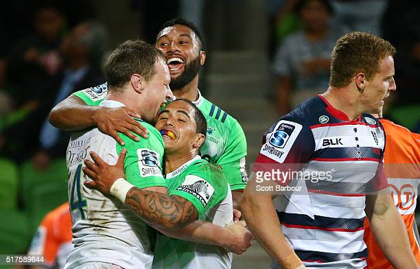 Jack Wilson of the Highlanders is congratulated by his teammates after scoring a try during the round five Super Rugby match between the Melbourne...
