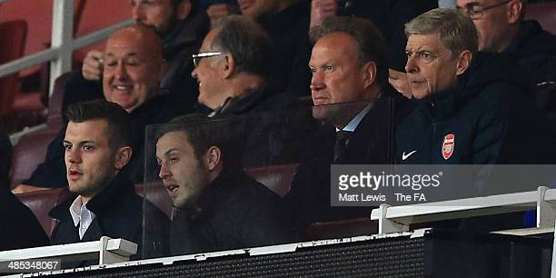 Jack Wiltshire of Arsenal and Arsene Wenger manager of Arsenal watch from the stands during the FA Youth Cup Semi Final Second Leg match between...