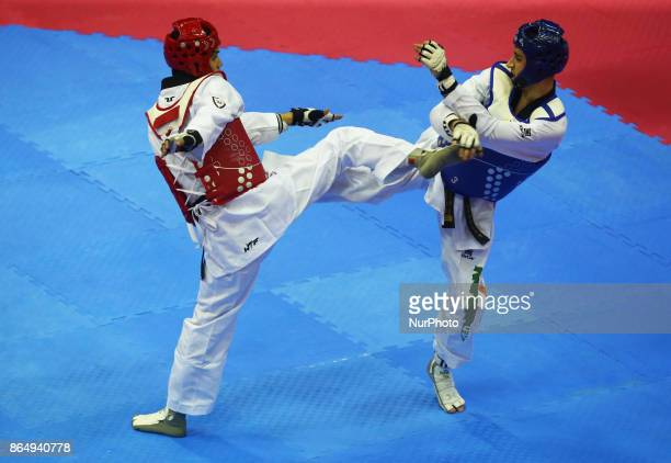 Jack Woolley of Ireland against Cesar Rodriguez of Mexico Competes in the Seniors Male A 58 during 2017 London World Taekwondo Grand Prix G4 at...