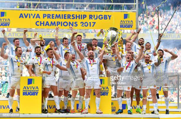 Jack Yeandle of Exeter Chiefs and Gareth Steenson of Exeter Chiefs lift The Aviva Premiership trophy after the Aviva Premiership Final between Wasps...