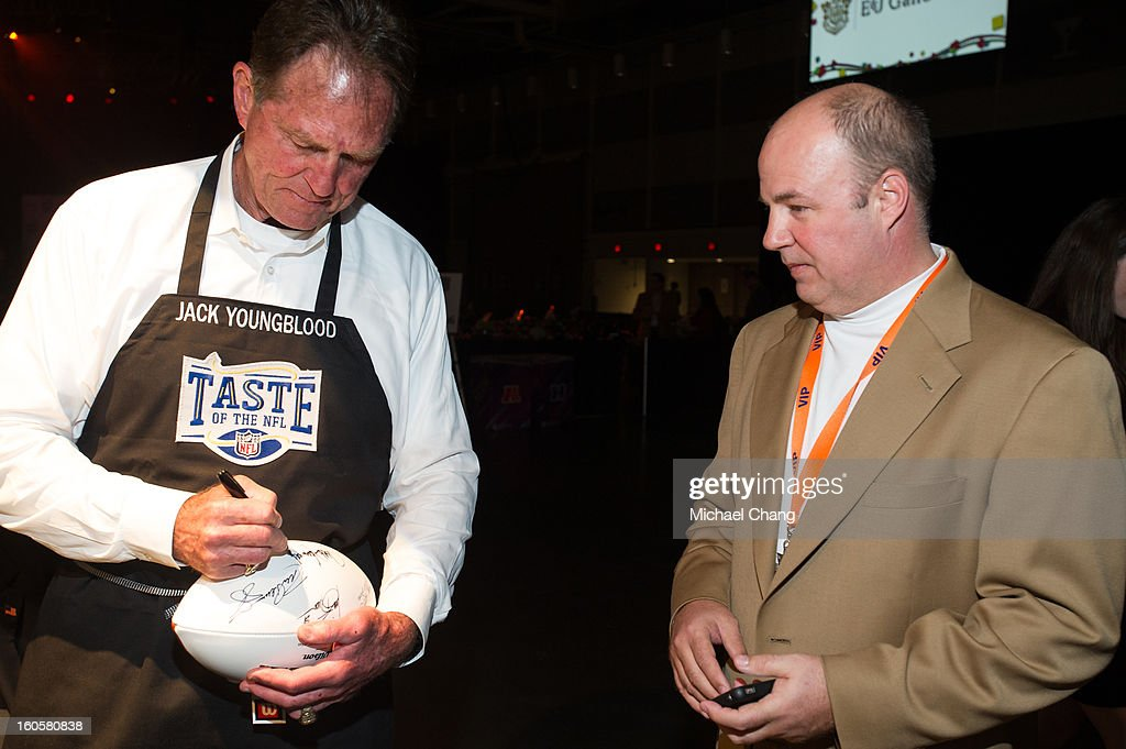 Jack Youngblood signs a football for a fan during the 2013 Taste of the NFL at the Ernest N. Morial Convention Center on February 2, 2013 in New Orleans, Louisiana.
