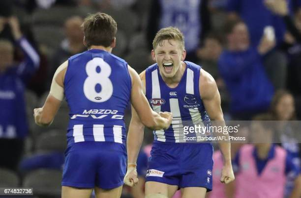 Jack Ziebell and Nathan Hrovat of the Kangaroos celebrate at the final siren and winning the round six AFL match between the North Melbourne...