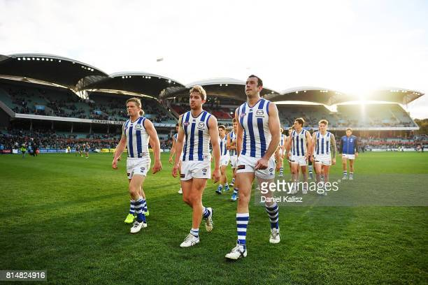 Jack Ziebell Daniel Nielson and Todd Goldstein of the Kangaroos walk from the ground looking dejected after being defeated by the Power during the...
