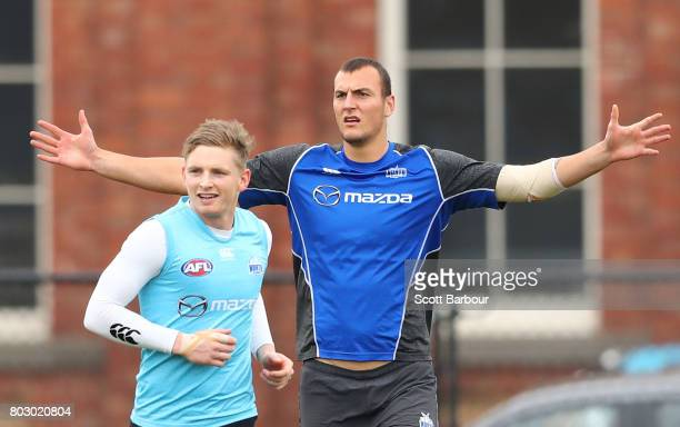Jack Ziebell of the Kangaroos and Braydon Preuss of the Kangaroos look on during a North Melbourne Kangaroos AFL training session at Arden Street...