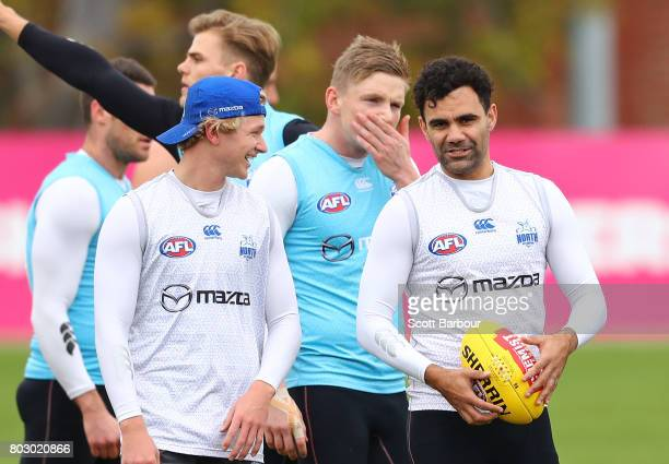 Jack Ziebell of the Kangaroos and Lindsay Thomas of the Kangaroos look on during a North Melbourne Kangaroos AFL training session at Arden Street...