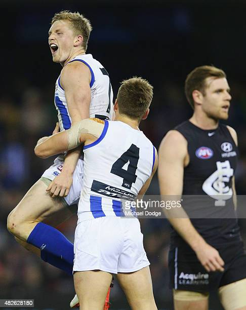 Jack Ziebell of the Kangaroos celebrates a goal with Shaun Higgins during the round 18 AFL match between the Carlton Blues and the North Melbourne...