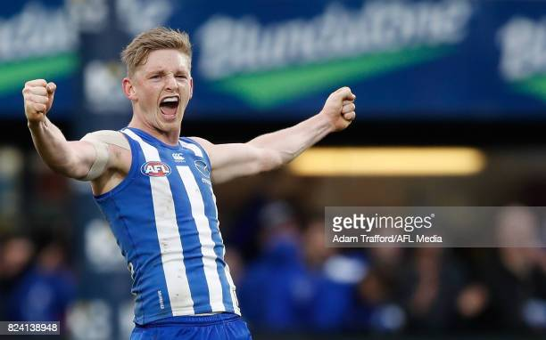 Jack Ziebell of the Kangaroos celebrates on the final siren during the 2017 AFL round 19 match between the North Melbourne Kangaroos and the...