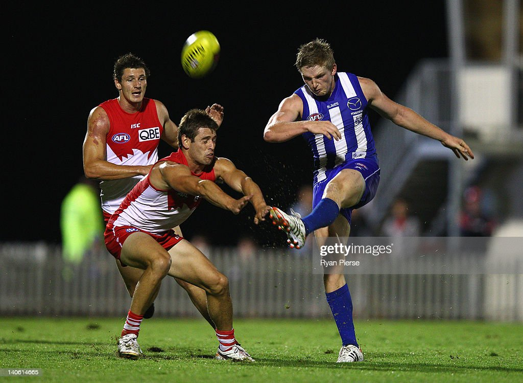 Jack Ziebell of the Kangaroos gets his kick away despite pressure from Nick Smith of the Swans during the round two NAB Cup AFL match between the Sydney Swans and the North Melbourne Kangaroos at Bruce Purser Oval on March 3, 2012 in Sydney, Australia.