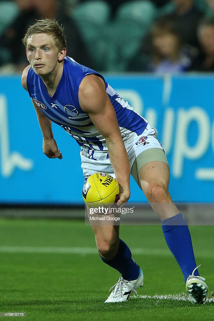 Jack Ziebell of the Kangaroos handpasses the ball during the round two AFL NAB Challenge match between the Hawthorn Hawks and the North Melbourne...