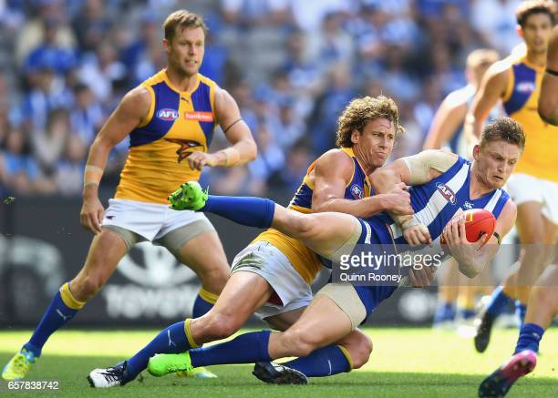 Jack Ziebell of the Kangaroos is tackled by Matt Priddis of the Eagles during the round one AFL match between the North Melbourne Kangaroos and the...