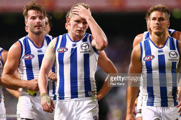 Jack Ziebell of the Kangaroos leads his team from the field after being defeated during the round five AFL match between the Fremantle Dockers and...