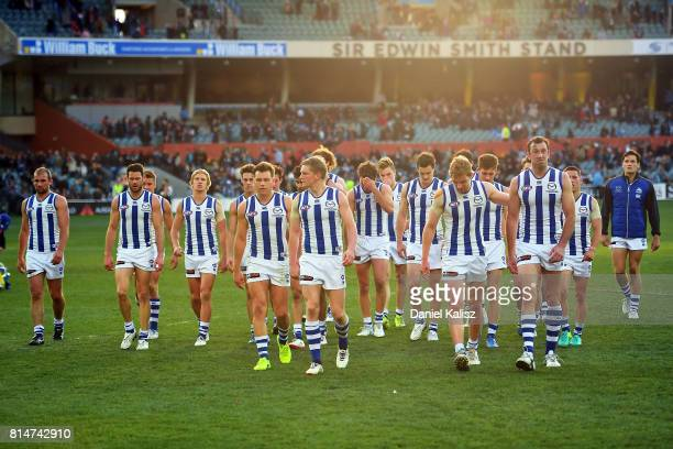 Jack Ziebell of the Kangaroos leads his team from the field looking dejected after being defeated by the Power during the round 17 AFL match between...