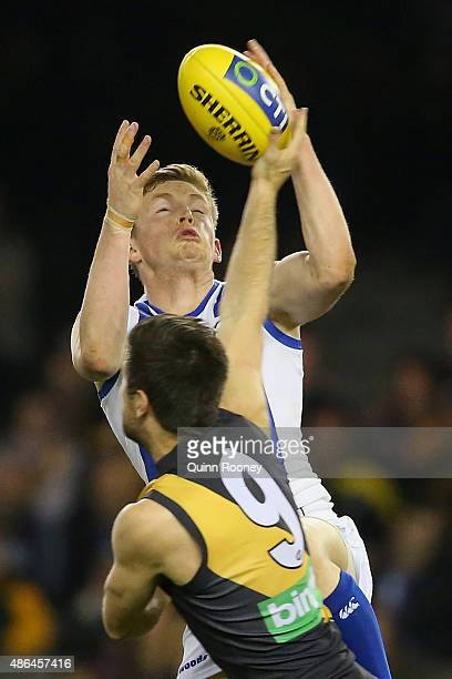 Jack Ziebell of the Kangaroos marks infront of Trent Cotchin of the Tigers during the round 23 AFL match between the Richmond Tigers and the North...