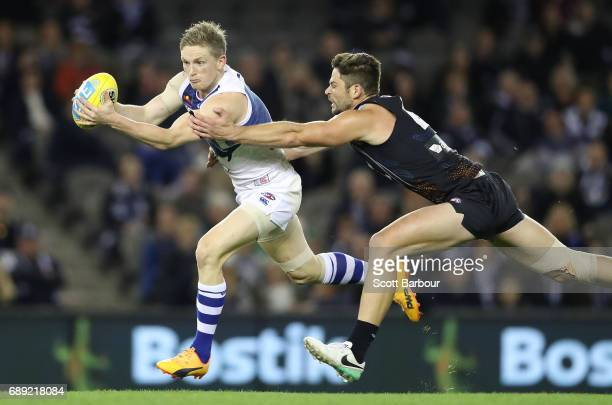 Jack Ziebell of the Kangaroos runs with the ball during the round 10 AFL match between the Carlton Blues and the North Melbourne Kangaroos at Etihad...