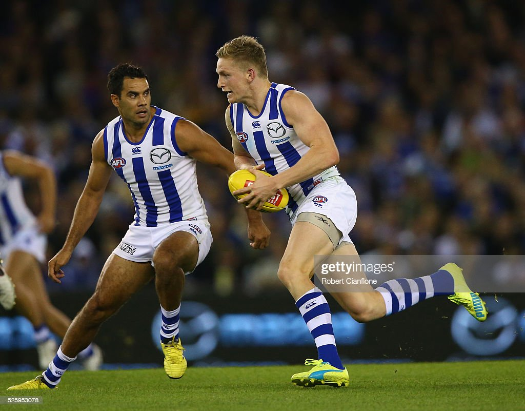 Jack Ziebell of the Kangaroos runs with the ball during the round six AFL match between the North Melbourne Kangaroos and the Western Bulldogs at Etihad Stadium on April 29, 2016 in Melbourne, Australia.