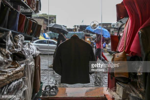 A jacket is displayed in the window of a leather goods store in the Dharavi area of Mumbai India on Tuesday July 18 2017 India's new goods and...