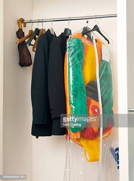 Jackets, umbrella and costume in wardrobe