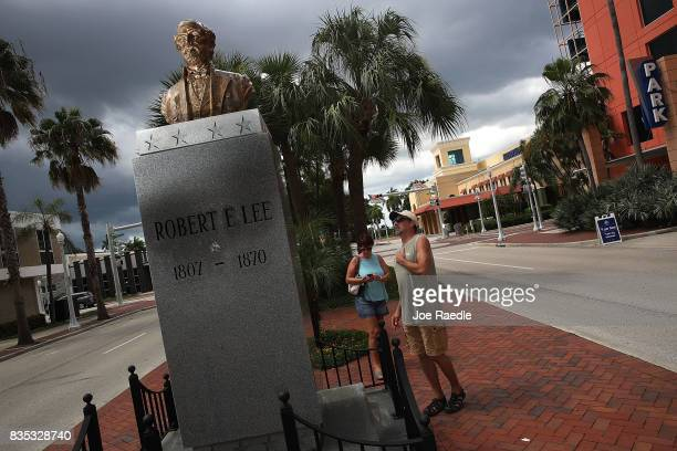 Jacki Lewan and Steve Lewan from Pittsburgh Pennsylvania look on at a bronze bust of Confederate general Robert E Lee on display in the median on...