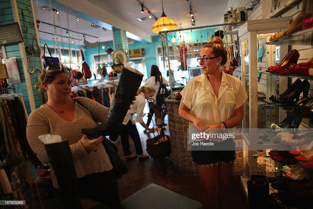 Jacki Stanley (R), who was hired full time by the Sale Rack store three weeks ago, helps Denise Kolb (L) as she shops on December 7, 2012 in Miami, Florida. The U.S. Labor Department releases a study showing the economy added 146,000 jobs in November, and the unemployment rate fell to 7.7 percent from 7.9 percent the previous month.